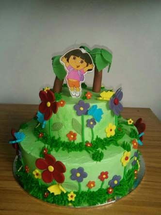 Two tired Dora in the forest cake